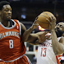 Houston Rockets' James Harden (13) drives against Milwaukee Bucks' Larry Sanders (8) during the first half of an NBA basketball game, Saturday, Feb. 8, 2014, in Milwaukee The Associated Press