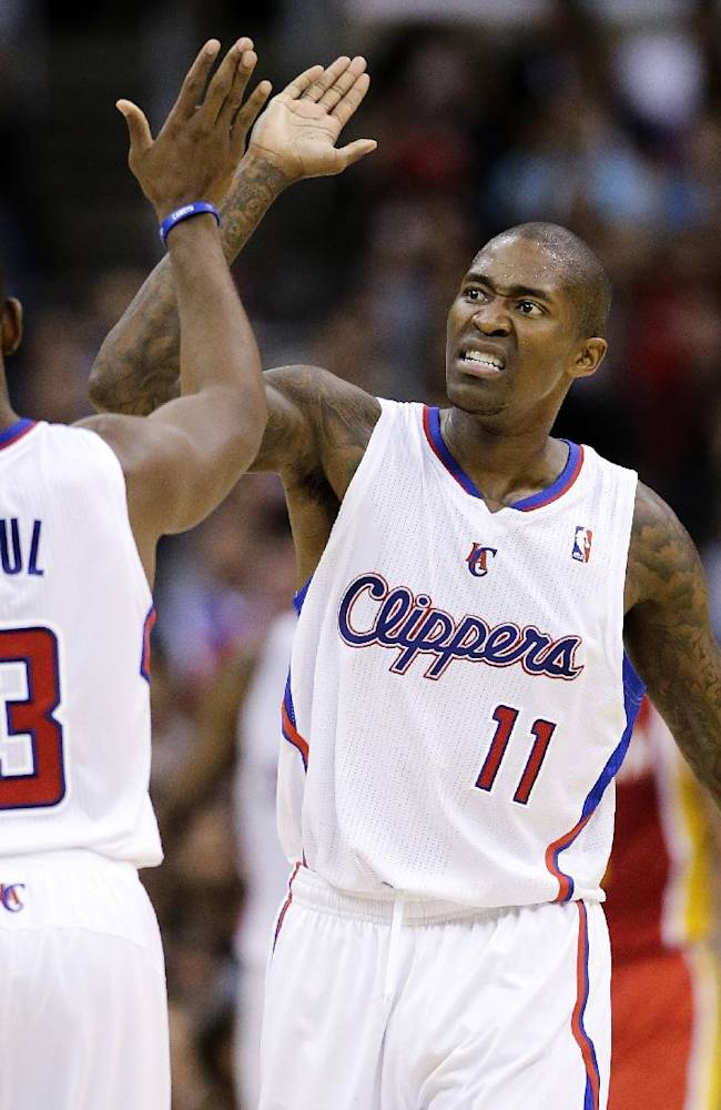 Los Angeles Clippers' Jamal Crawford, right, high-fives Chris Paul after making a basket during the second half of an NBA basketball game against the Houston Rockets on Monday, Nov. 4, 2013, in Los Angeles. The Clippers won 137-118