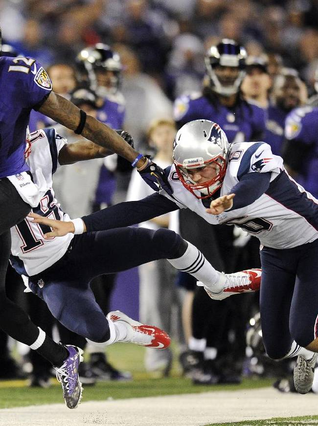 In this Dec. 22, 2013 file photo, Baltimore Ravens wide receiver Jacoby Jones, from left, rushes a punt return out of bounds past New England Patriots' Matthew Slater and Ryan Allen during an NFL football game in Baltimore. The Ravens and Jones agreed on a four-year contract Wednesday, March 12, 2014, after he drew interest from other teams as a free agent