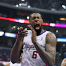 Los Angeles Clippers center DeAndre Jordan celebrates after scoring during the first half in Game 1 of an opening-round NBA basketball playoff series against the Golden State Warriors, Saturday, April 19, 2014, in Los Angeles The Associated Press