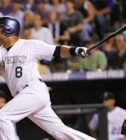 Colorado Rockies Yorvit Torrealba hits a ground rule double scoring two runs during the sixth inning of a baseball game, Wednesday, Aug. 28, 2013, in Denver. (AP Photo/Barry Gutierrez)