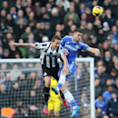 Chelsea's Gary Cahill, right heads the ball with Newcastle's Luuk De Jong during their English Premier League soccer match between Chelsea and Newcastle United in London, Saturday, Feb. 8, 2014
