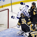 Tampa Bay Lightning center Steven Stamkos (91) celebrates after scoring against Boston Bruins goalie Tuukka Rask (40) as Bruins defenseman Adam McQuaid (54) and center Patrice Bergeron (37) watch during the first period of an NHL hockey game in Boston, Tu