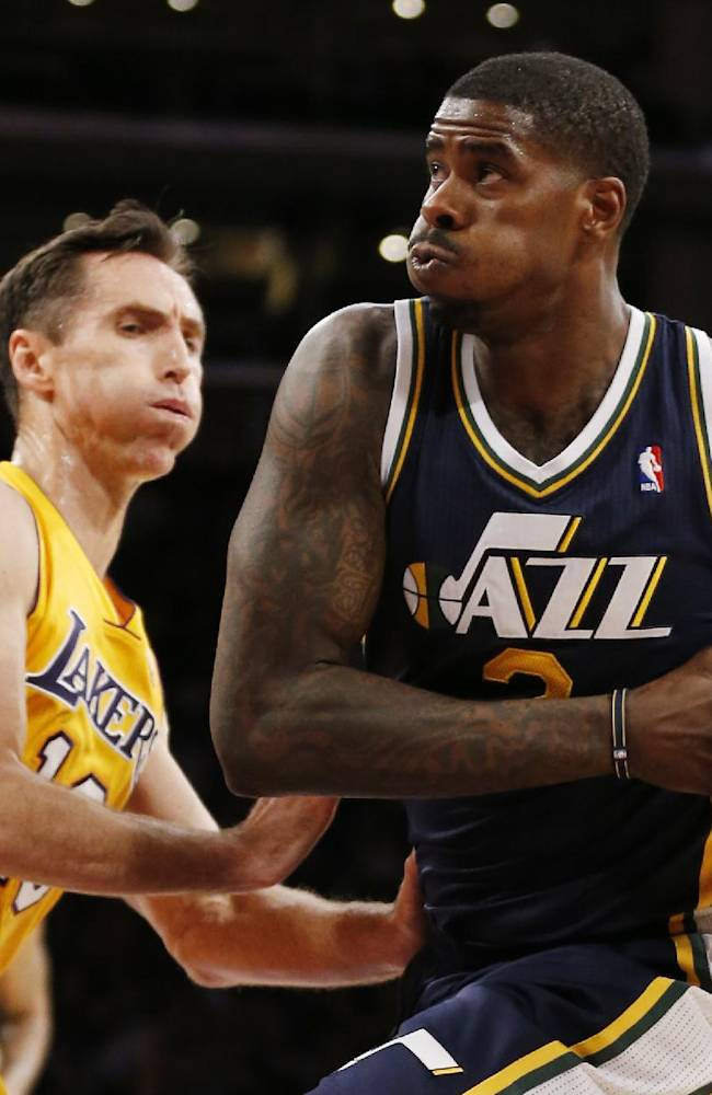 Utah Jazz's Marvin Williams, right, drives past Los Angeles Lakers Steve Nash during the first half of an NBA basketball game in Los Angeles, Tuesday, Feb. 11, 2014