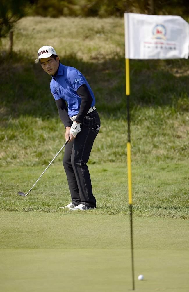 In this photo released by OneAsia, Liang Wenchong of China watches his shot during the final round of the Nanshan China Masters golf tournament at the Nanshan International Golf Club in Longkou, Shandong Province, China Sunday, Oct. 13, 2013