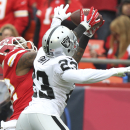 Kansas City Chiefs wide receiver Dwayne Bowe (82) makes a 37-yard catch against the defense of Oakland Raiders cornerback Tarell Brown (23) during the first half of an NFL football game in Kansas City, Mo., Sunday, Dec. 14, 2014 The Associated Press