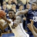 Villanova's Mouphtaou Yarou (13) commits his fifth foul and fouls out as he reaches for the ball after Pittsburgh's Talib Zanna (42) got a rebound in overtime of an NCAA college basketball game on Sunday, March 3, 2013, in Pittsburgh. Pittsburgh won 73-64. (AP Photo/Keith Srakocic)