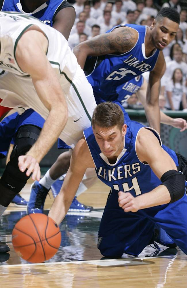 Grand Valley State's Ernijs Ansons, lower right, and Michigan State's Matt Costello chase a loose ball during the second half of an NCAA college basketball exhibition game, Tuesday, Oct. 29, 2013, in East Lansing, Mich. Michigan State won 101-52