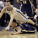 San Antonio Spurs' Manu Ginobili (20), of Argentina, and Indiana Pacers' Orlando Johnson, bottom, dive for a loose ball during the first half on an NBA basketball game Saturday, Dec. 7, 2013, in San Antonio. (AP Photo/Eric Gay)