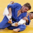 Nicholas Delpopolo (L) of the U.S. (blue) fights with South Korea's Wang Ki-Chun during the men's -73kg quarter-final judo match at the London 2012 Olympic Games in a July 30, 2012 file photo. Delpopolo has been expelled from the Olympic Games after testing positive for marijuana. Delpopolo, who had finished seventh in the 73kg judo event, accepted his expulsion, but said that the positive test had been caused by inadvertently eating food that he did not realise had been baked with the recreational drug. REUTERS/Kim Kyung-Hoon/files