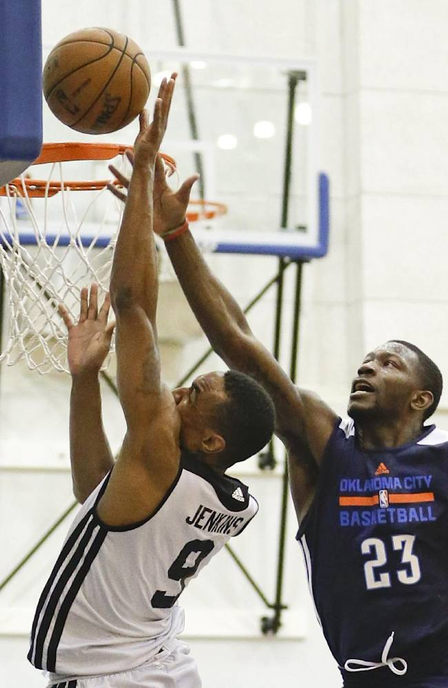 Oklahoma City Thunder's Mario Little tries to block a shot by Brooklyn Nets' Michael Jenkins, left, during an NBA summer league basketball game in Orlando, Fla., Monday, July 7, 2014