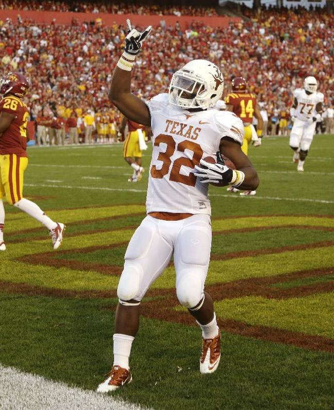 Texas running back Johnathan Gray celebrates after scoring on a 45-yard touchdown run in the first half of an NCAA college football game against Iowa State, Thursday, Oct. 3, 2013, in Ames, Iowa