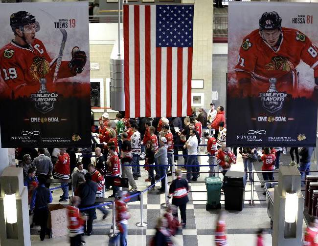 Hockey fans attend Game 2 of an NHL hockey second-round playoff series between the Minnesota Wild and the Chicago Blackhawks in Chicago, Sunday, May 4, 2014