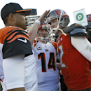 Cincinnati Bengals quarterback Jason Campbell, left, and quarterback Andy Dalton (14) talk to Tampa Bay Buccaneers quarterback Josh McCown (12) after the Bengals defeated the Buccaneers 14-13 in an NFL football game Sunday, Nov. 30, 2014, in Tampa, Fla Th