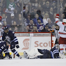 Carolina Hurricanes' Andrei Loktionov (8) and Jiri Tlusty (19) celebrate Eric Staal's goal against Winnipeg Jets goaltender Al Montoya (35), and Jets' Blake Wheeler (26), Dustin Byfuglien (33) and Adam Pardy (2) during the second period of an NHL hockey