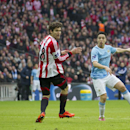 Manchester City's Samir Nasri, right, scores past Sunderland's Marcos Alonso, centre, during the League Cup Final at Wembley Stadium, London, England, Sunday March 2, 2014