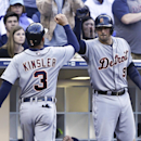 Detroit Tigers' Ian Kinsler is greeted by Nick Castellanos after scoring on a double by Miguel Cabrera in the third inning of a baseball game against the San Diego Padres Saturday, April 12, 2014, in San Diego The Associated Press