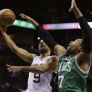 San Antonio Spurs' Tony Parker (9), of France, shoots over Jared Sullinger (7) during the first half of an NBA basketball game, Wednesday, Nov. 20, 2013, in San Antonio. (AP Photo/Eric Gay)