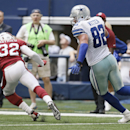 Arizona Cardinals free safety Tyrann Mathieu (32) makes an interception reception as Dallas Cowboys tight end Jason Witten (82) goes for a tackle during the second half of an NFL football game Sunday, Nov. 2, 2014, in Arlington, Texas The Associated Press