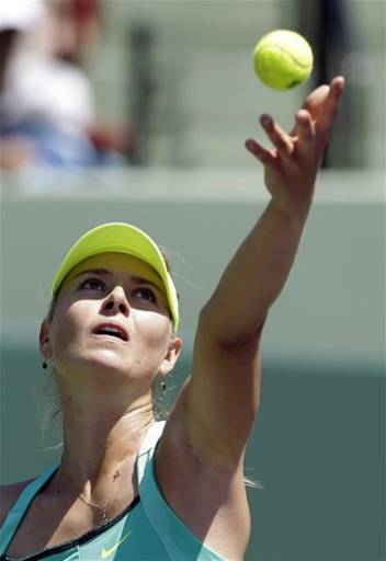Maria Sharapova, of Russia, serves to Serena Williams during the final match of the Sony Open tennis tournament, Saturday, March 30, 2013, in Key Biscayne, Fla