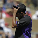 Colorado Rockies starting pitcher Franklin Morales adjust his hat during the second inning of a spring exhibition baseball game against the Seattle Mariners, Saturday, March 29, 2014, in Scottsdale, Ariz The Associated Press