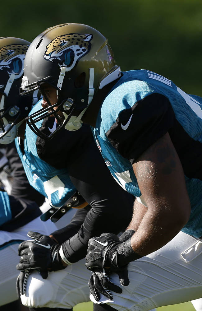 Jacksonville Jaguars' players take part in their football practice at the Pennyhill Park Hotel and Spa in Bagshot, England, Wednesday, Oct. 23, 2013. The Jaguars face the San Francisco 49ers on Sunday in a NFL football game at Wembley Stadium in London