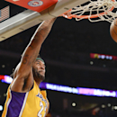 Los Angeles Lakers forward Jordan Hill dunks on a fast break in the first half of an NBA basketball game against the Dallas Mavericks, Friday, April 4, 2014, in Los Angeles The Associated Press