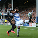 Queens Park Rangers' Armand Traore, right, battles for possession of the ball with Hull City's Ahmed Elmohamady during their English Premier League soccer match at Loftus Road, London, Saturday, Aug. 16, 2014