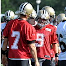 New Orleans Saints quarterbacks Luke McCown (7) and Drew Brees (9) stand on the field during NFL football training camp in White Sulphur Springs, W. Va., Friday, July 25, 2014 The Associated Press