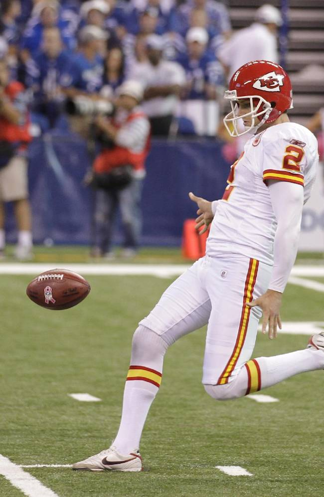 In this Oct. 10, 2010 file photo, Kansas City Chiefs' Dustin Colquitt (2) punts during an NFL football game against the Indianapolis Colts in Indianapolis. The Colquitts are to punting what the Mannings are to passing, and this first family of punters had an inauspicious start, a safety on the patriarch's very first punt at the University of Tennessee in 1975