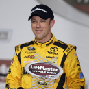 Matt Kenseth poses with the trophy after winning the pole position for Sunday's NASCAR Sprint Cup series auto race at Charlotte Motor Speedway in Concord, N.C., Thursday, May 21, 2015. (AP Photo/Chuck Burton)