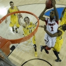 Louisville guard Russ Smith (2) shoots against Michigan during the first half of the NCAA Final Four tournament college basketball championship game Monday, April 8, 2013, in Atlanta. (AP Photo/NCAA Photos, Chris Steppig)