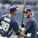 San Diego Padres starting pitcher Andrew Cashner, right, who one-hit the Detroit Tigers Friday, talks with Sunday's starter Tyson Ross during pregame warmups for a baseball game Saturday, April 12, 2014, in San Diego The Associated Press