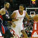 HOUSTON, TX - DECEMBER 20: Trevor Ariza #1 of the Houston Rockets drives with the basketball against Mike Scott #32 of the Atlanta Hawks during their game at the Toyota Center on December 20, 2014 in Houston, Texas. (Photo by Scott Halleran/Getty Images)