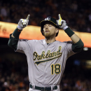 Oakland Athletics' Ben Zobrist celebrates after hitting a home run against the San Francisco Giants in the seventh inning of a baseball game, Friday, July 24, 2015, in San Francisco. (AP Photo/Ben Margot)