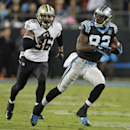 Carolina Panthers' Jerricho Cotchery (82) runs after a catch as New Orleans Saints' Marcus Ball (36) defends in the second half of an NFL football game in Charlotte, N.C., Thursday, Oct. 30, 2014 The Associated Press