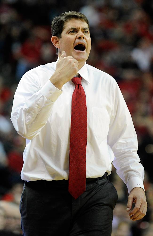 UNLV coach Dave Rice reacts during the second half of an NCAA college basketball game against Illinois on Tuesday, Nov. 26, 2013 in Las Vegas. Illinois won 61-59