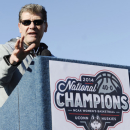 Connecticut head coach Geno Auriemma speaks to fans during a rally aon campus celebrating his team's NCAA title, Wednesday, April 9, 2014, in Storrs, Conn. (AP Photo/Jessica Hill)