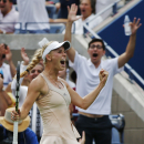 Caroline Wozniacki, of Denmark, reacts after winning a point against Maria Sharapova, of Russia, during the fourth round of the 2014 U.S. Open tennis tournament, Sunday, Aug. 31, 2014, in New York. (AP Photo/Kathy Willens)