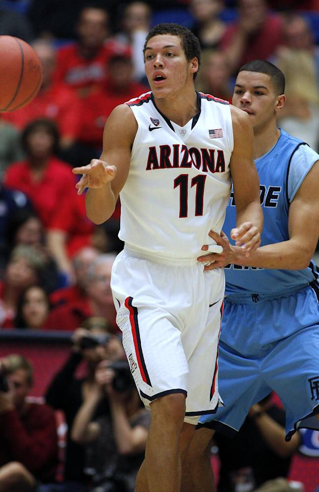 Arizona's Aaron Gordon (11) passes the ball away from the pressing defense of Rhode Island's Jarelle Reischel, in back, in the second half of an college NCAA basketball game, Tuesday, Nov. 19, 2013 in Tucson, Ariz. This is in the second round of the NIT. Arizona won 87 - 59