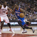 Philadelphia 76ers guard Tony Wroten (8) drives to the basket against Toronto Raptors forward Patrick Patterson (54) during second half NBA actionin Toronto on Wednesday, April 9, 2014 The Associated Press