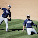 San Diego Padres starting pitcher Donn Roach, left, throws Arizona Diamondbacks' Eric Chavez out at first as third baseman Alex Castellanos is near during the sixth inning of a spring training baseball game in Scottsdale, Ariz., Sunday, March 9, 2014 The