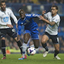 Chelsea's Demba Ba, center, fights for the ball with Tottenham Hotspur's Kyle Naughton and Sandro, left, during their English Premier League soccer match, at the Stamford Bridge Stadium in London, Saturday March 8, 2014
