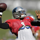 Carolina Panthers' Cam Newton looks to pass during an NFL football practice at their training camp in Spartanburg, S.C., Tuesday, July 29, 2014 The Associated Press