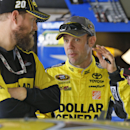 Matt Kenseth talks to his crew in the garage as he waits for practice to begin for Sunday's Sprint Cup Series auto race at Martinsville Speedway in Martinsville, Va., Saturday, Oct. 25, 2014. (AP Photo/Steve Helber)