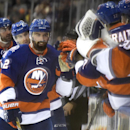 New York Islanders defenseman Nick Leddy (2) celebrates his goal with teammates in the third period of an NHL hockey game against the Philadelphia Flyers at Nassau Coliseum on Monday, Jan. 19, 2015, in Uniondale, N.Y. The Islanders won 7-4 The Associated