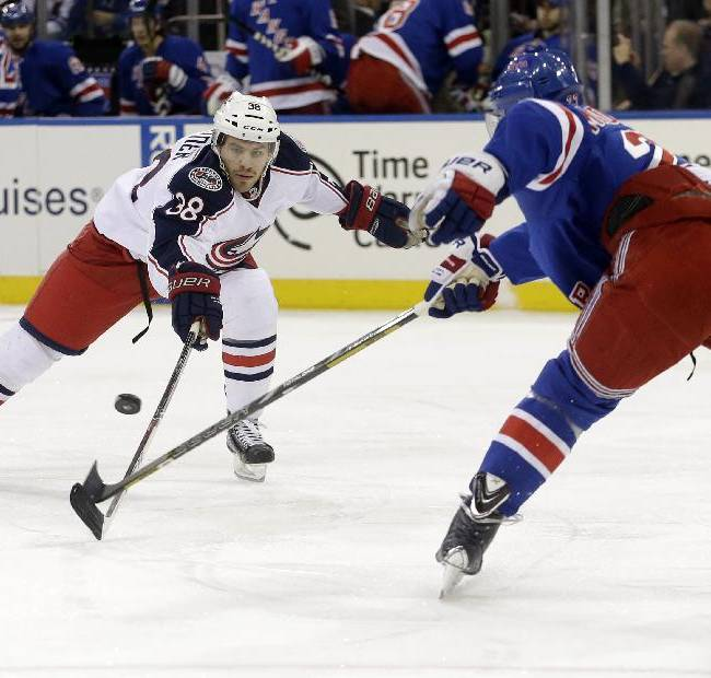 Columbus Blue Jackets' Boone Jenner (38) and New York Rangers' Ryan McDonagh (27) fight for control of the puck during the first period of an NHL hockey game, Monday, Jan. 6, 2014, in New York