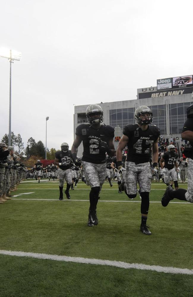 Army takes the field for an NCAA college football game against Western Kentucky Saturday, Nov. 9, 2013, in West Point, N.Y