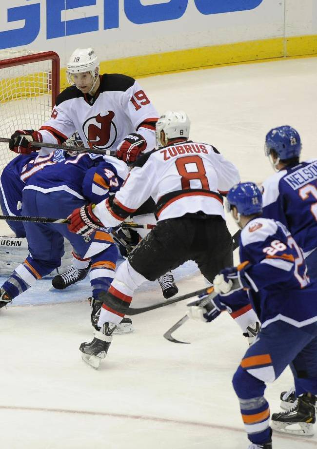 New Jersey Devils' Jaromir Jagr (68) shoots the puck past New York Islanders goalie Evgeni Nabokov (20) to score his 700th goal as Devils' Travis Zajac (19) and  Dainius Zubrus (8) look on in the  second period of an NHL hockey game on Saturday, March 1, 2014, in Uniondale, N.Y