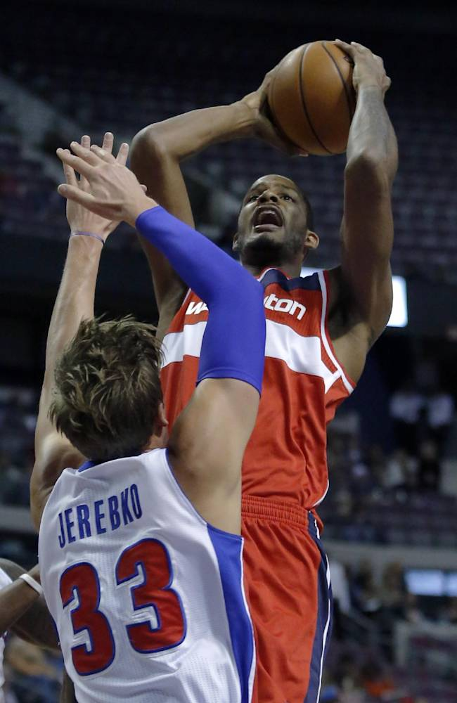 Washington Wizards forward Trevor Ariza takes a shot against Detroit Pistons forward Jonas Jerebko (33) during the first half of a preseason NBA basketball game Tuesday, Oct. 22, 2013, in Auburn Hills, Mich